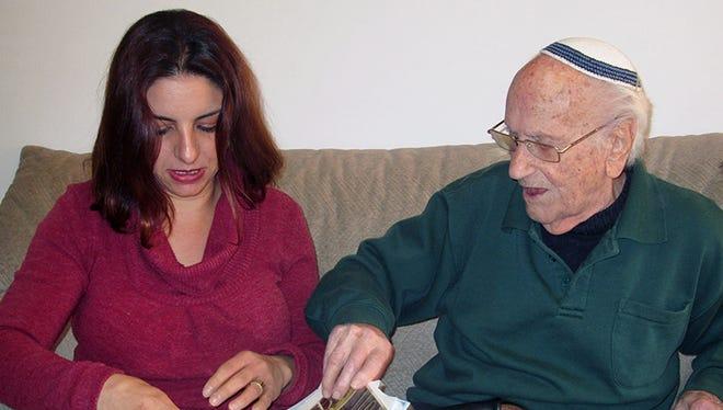 Jancy Benvenishti, the Jerusalem coordinator for the International Fellowship of Christians and Jews, visits Avraham Marek, a 103-year-old Holocaust survivor, in his Jeusalem home.