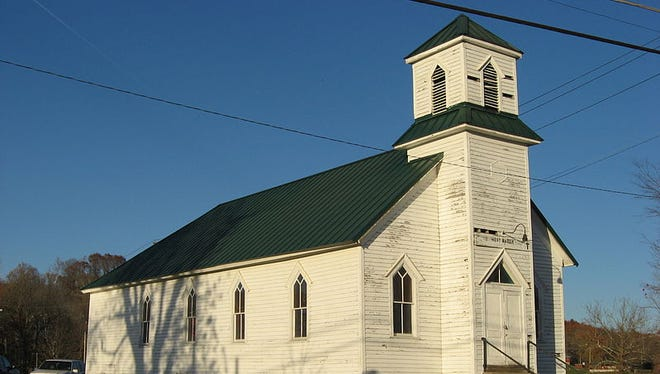 Front and western side of the First Baptist Church, located on the northwestern corner of the junction of Elm and Sinclair Streets in West Baden Springs, Indiana. Built in 1920, it is listed on the National Register of Historic Places.