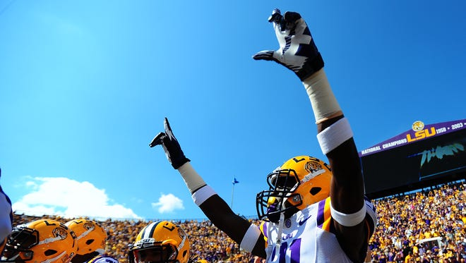 LSU Tigers defensive back Rashard Robinson (21) walks out of the tunnel prior to the first half of an NCAA football game against the Florida Gators at Tiger Stadium in Baton Rouge, LA, Saturday, Oct. 12, 2013.  Paul Kieu, The Daily Advertiser