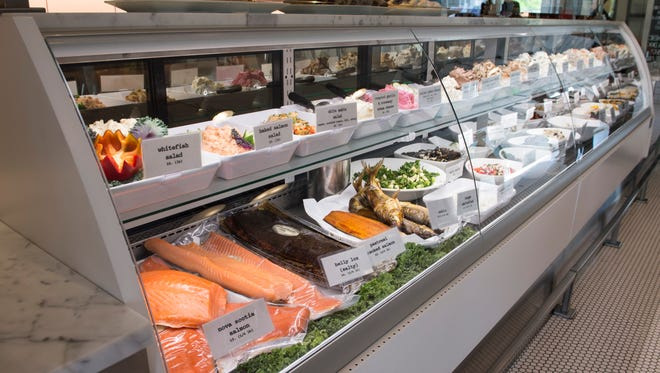 The deli case at Proper Bagel is stocked with an astonishing array of salads, sides of pastrami salmon, lox, sable and bowls mounded with flavored cream cheeses.