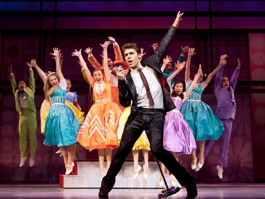Nolan Gerard Funk (center) and company  in a 2009 Broadway