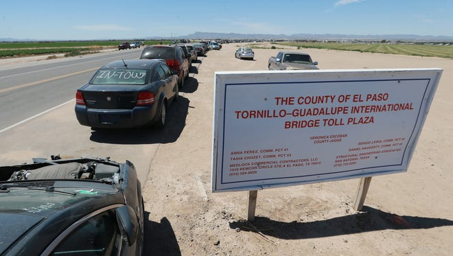 Cars are lined up on the roadside near the Tornillo port-of-entry to enter Mexico.
