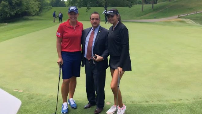 From left, LPGA pro Katherine Kirk, Green Bay Mayor Jim Schmitt, and amateur golfer Alexa Pano pose for a photo at Thornberry Creek golf course June 5. Pano  will join Kirk in the field of 144 golfers as one of three exempt golfers the Oneida can invite to play in the event.