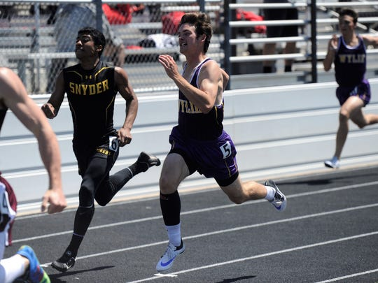 Wylie's Brandon Sanders finishes the 200-meter dash final during the District 5-4A meet at Bulldog Stadium on Thursday, April 5, 2018. Sanders finished third to qualify for the area meet.