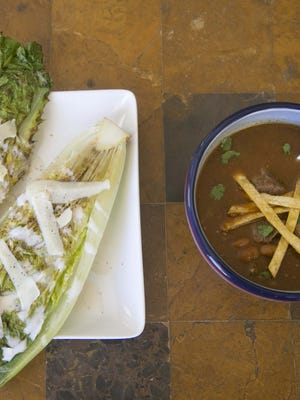 Caesar Salad with Grilled Romaine Hearts and Shaved Pecorino and Beef tortilla soup at Robin Miller's home in Scottsdale on Tuesday, February 21, 2017.