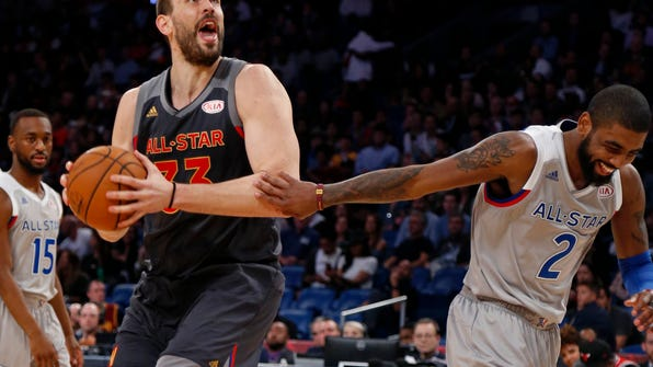 Western Conference center Marc Gasol of the Vancouver Grizzlies (33) and Eastern Conference guard Kyrie Irving of the Cleveland Cavaliers (2) clown around during the second half of the NBA All-Star basketball game in New Orleans, Sunday, Feb. 19, 2017. (AP Photo/Max Becherer)