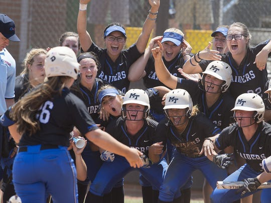 Members of the MTSU softball team celebrate as Kristin Uselton nears home plate after her grand slam in the fifth inning of their game against top-seeded FAU in the Conference USA championship game in Charlotte, N.C., on May 12, 2018.