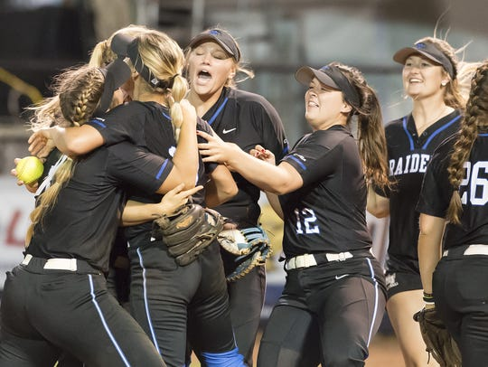 Members of the No. 6 MTSU softball team celebrate after defeating No. 3 FIU in the Conference USA tournament on May 9.