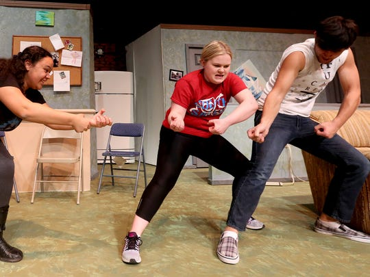 Drama students Tyler Kaufman, from left, Lemon Marin,