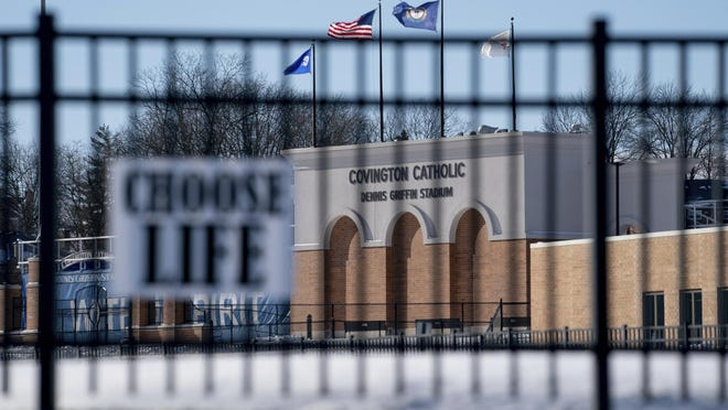 Flags fly over the Covington Catholic High School stadium in Park Kills, Ky., Jan 20, 2019.