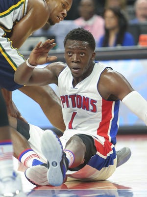 Pistons guard Reggie Jackson gets the loose ball against Jazz guard Rodney Hood during the first period of the Pistons' 92-87 win Wednesday at the Palace.