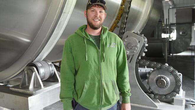 Todd Olander's new business, Root Shoot Malting, grows, harvests and malts grains for brewing in Loveland.