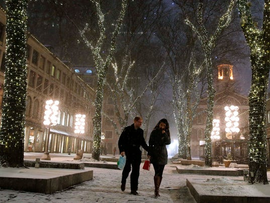 Snow begins to fall in Boston