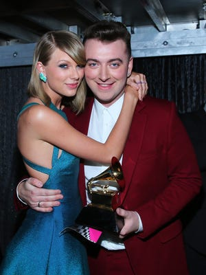 Recording artists Taylor Swift and Sam Smith after Smith won for Best New Artist at The 57th Annual GRAMMY Awards.