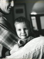 John and his oldest son, Henry, in 2002. Henry has helped note if John's blood sugar seemed low, keeping an extra set of eyes on him.