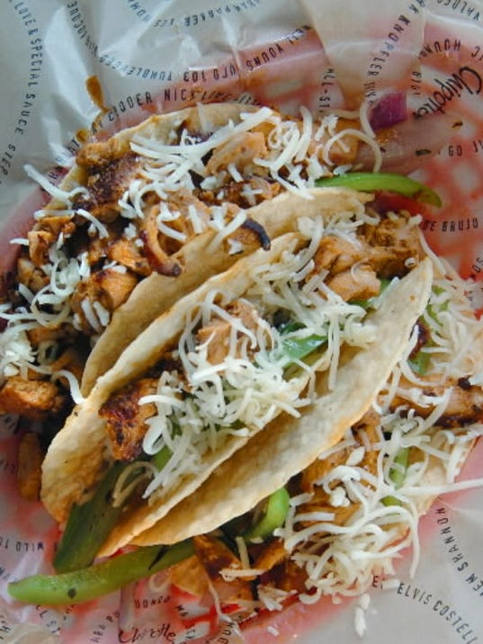 A trio of crisp tacos can be filled with steak, chicken, carnitas or barbacoa.