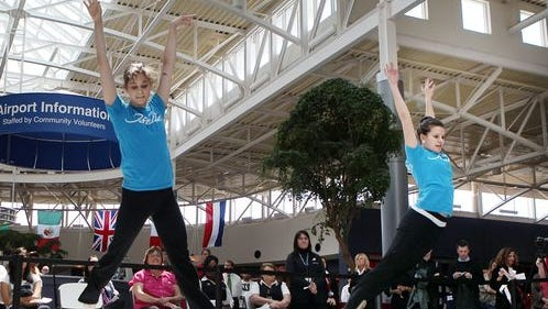 Brianna Habel (left) and Samantha DeBenedictis, dancers with the Cincinnati Ballet, performed in Concourse B at Cincinnati/Northern Kentucky International Airport as a promotion for ArtsWave, an annual community fundraising campaign for the arts in 2011.