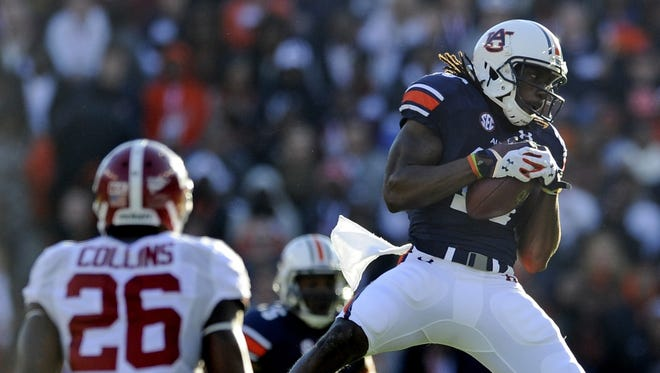 Auburn Wide receiver Sammie Coates makes a catch against Alabama during the first half Saturday.  MICKEY WELSH/ADVERTISER Auburn Wide receiver Sammie Coates (18) catches a pass against Alabama in first half action in the Iron Bowl at Jordan-Hare Stadium in Auburn, Ala. on Saturday November 30, 2013. (Mickey Welsh, Montgomery Advertiser)