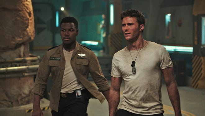 "John Boyega (left) and Scott Eastwood star in ""Pacific Rim Uprising."""