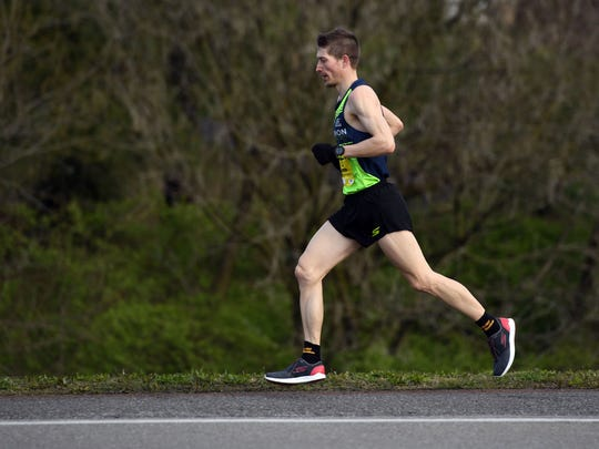 Bryan Morseman crosses into South Knoxville in the final leg of the Covenant Health Knoxville Marathon on Sunday.