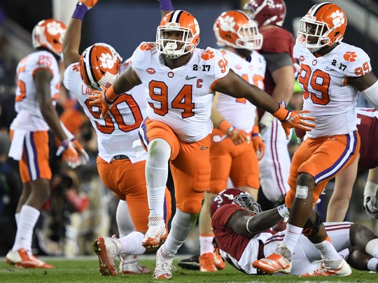 Defensive tackle Carlos Watkins (94), shown celebrating against Alabama in the national championship game, was selected by the Houston Texans with the No. 142 overall pick in the fourth round of the NFL draft.