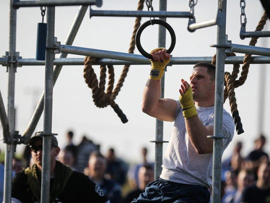 Airman Guy Morrish competes on the Alpha Warrior Battle