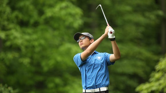 Scarsdale's Andy Fan tees off during the NYSPHSAA Boys Golf Championships at Robert Trent Jones Golf Course in Ithaca.
