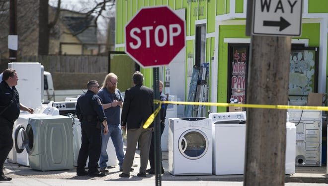 IMPD and Crime Lab personnel process the scene of a shooting at the corner of Elmira and West 30th streets that left an 8-year-old boy shot in the arm Tuesday, March 31, 2015.