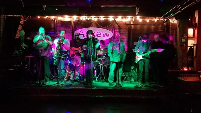 The Funky Autocrats perform at Askew, in Providence. The club has also been hosting album-listening parties and open-mic nights.
