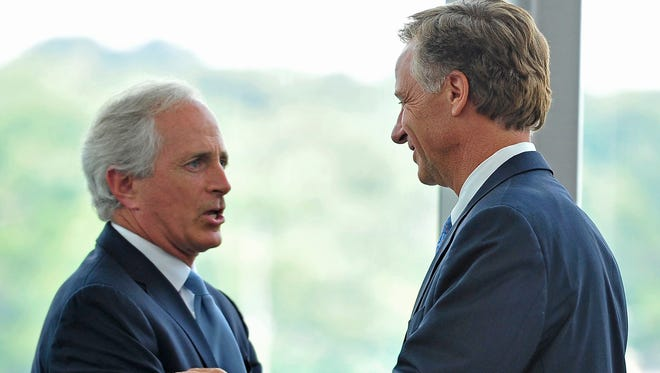 Gov. Bill Haslam, right, shakes hands with Sen. Bob Corker at a news conference in Chattanooga in 2014.