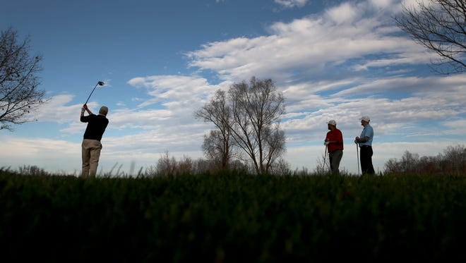 Kip Hale tees off at Ravenwood Golf Club on December 14 during a round of golf with friends.