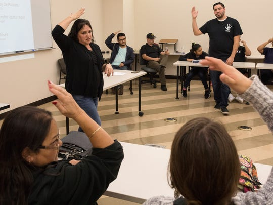 Linda Lugo, a Del Mar College adjunct instructor who is deaf, demonstrates how to sign hat during an American Sign Language class for Spanish speakers Tuesday, Feb. 20, 2018, in Del Mar College's West Campus Health Sciences Building 2. Her interpreter, Santiago Galvan (standing at right), demonstrates the same sign.
