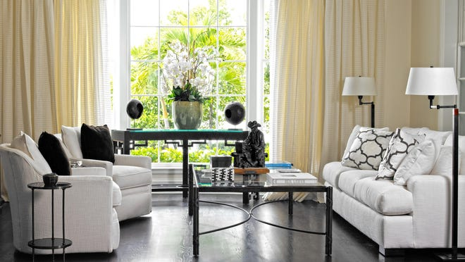 For summer decor, think light and soft, says decorator Carleton Varney. Designed for a home in Palm Beach, this family room has many of the hallmarks of summer, including mostly bare-wood floors, light-colored upholsery and soft yellow draperies at the windows.