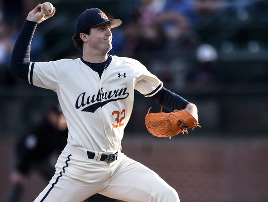 Auburn ace RHP Casey Mize (32) pitches six innings in a 4-2 loss against LSU on Friday, May 18, 2018, in Auburn, Ala.
