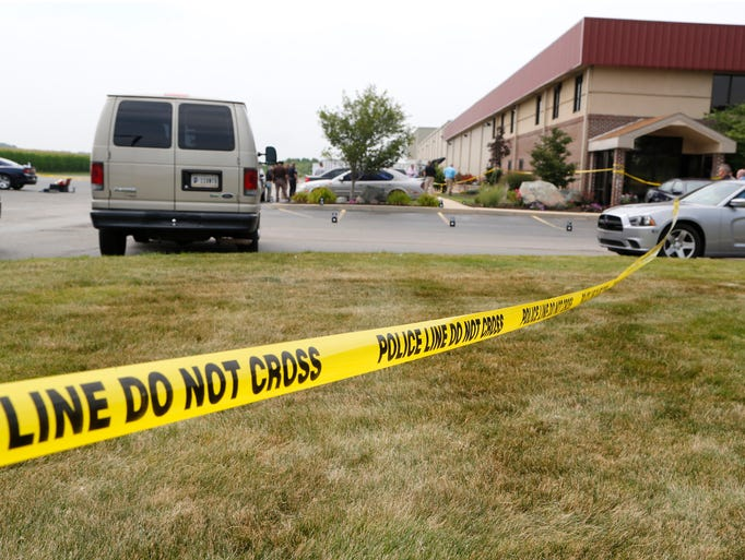 Police tape cordons off the area following a shooting in the parking lot of Jordan Manufacturing Tuesday, August 5, 2014, at 1200 S. Sixth in Monticello. According to White County Sheriff Patrick Shafer, police found a man dead in the parking lot shortly before noon. A second man was found dead in a car in the parking lot. A woman found in the passenger seat of the car was transported to IU Health White Memorial Hospital, where she was pronounced dead. A handgun was found at the scene.