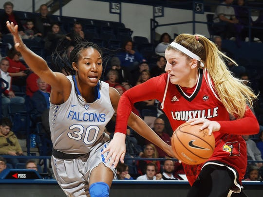 Louisville forward Sam Fuehring drives the ball past Air Force forward Naomi Hughes during the first half of an NCAA college basketball game at Air Force Academy, Colo., Wednesday, Dec. 20, 2017. Louisville won 62-50.