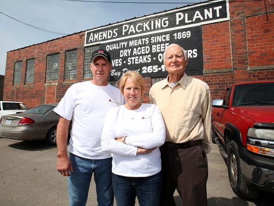 Kent, left, and Amy Weise are the current owners of Amend Packing in Des Moines. The five-generation business was passed down from Dick Amend, right. It will close Friday after 149 years in business.