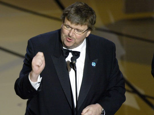 Michael Moore delivers his emphatic acceptance speech for the Best Documentary Feature at the 75th Academy Awards at the Kodak Theatre in March 2003.