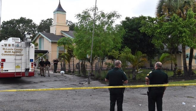 Officials investigate an overnight fire at the Fort Pierce Islamic Center Monday.