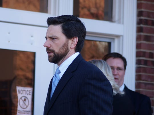 Deputy Attorney General John Donahue (center) and another