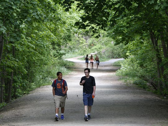 People walk on the Old Croton Aqueduct in Dobbs Ferry