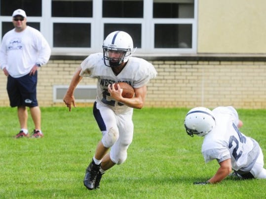 West York running back Brock Snellbaker (center) hopes to help the Bulldogs claim a sixth straight Division II title.