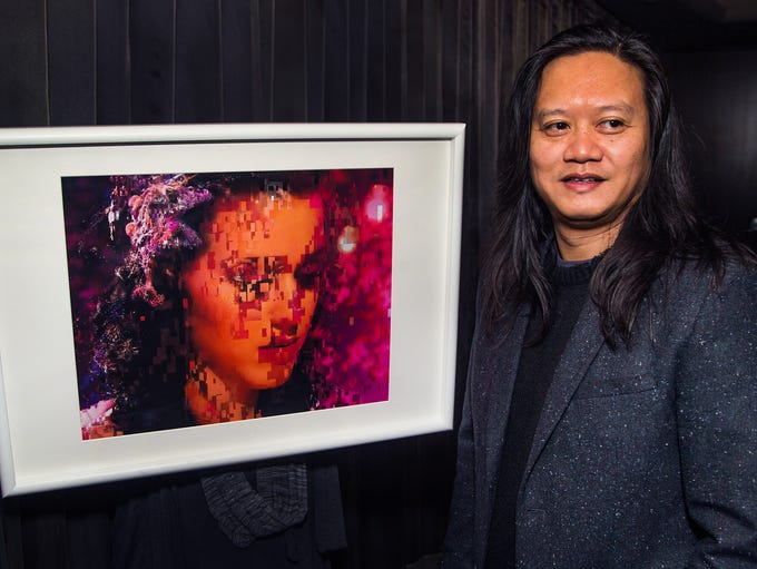 """Artist Rembrandt Quiballo poses with his work, """"Pop"""