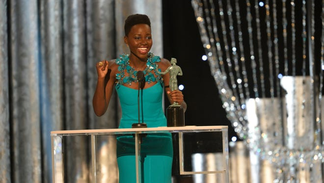 Lupita Nyong'o ecstatically accepts the award for female actor in a supporting role for her part in '12 Years a Slave.'