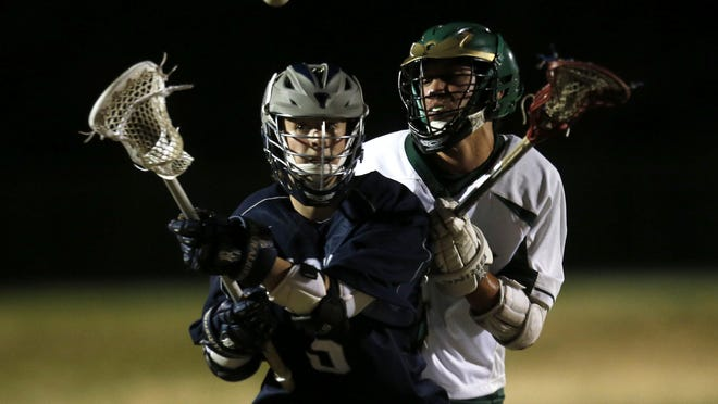 Maclay's Reid Ragsdale and Lincoln's Alex Bynum fight for the ball during their game at Lincoln High School on Tuesday, Feb. 23, 2016.