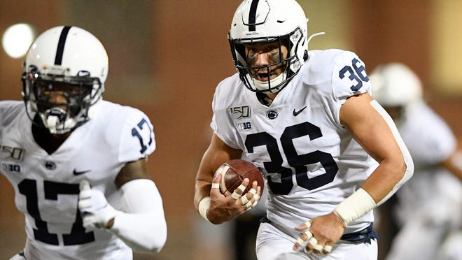 Penn State linebacker Jan Johnson (36) runs with the ball after he intercepted it during the first half of an NCAA college football game against Maryland, Friday, Sept. 27, 2019, in College Park, Md. (AP Photo/Nick Wass)