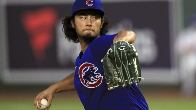 Chicago Cubs starting pitcher Yu Darvish delivers to a Kansas City Royals batter during the fifth inning of a baseball game at Kauffman Stadium in Kansas City, Mo., Wednesday.