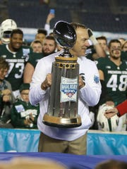 Michigan State coach Mark Dantonio with the trophy