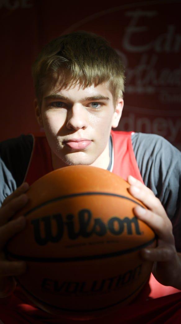 At 6-foot-9, Hendersonville junior basketball player