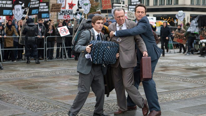 """Dave Franco (from left), Tom Wilkinson and Vince Vaughn star in """"Unfinished Business."""""""